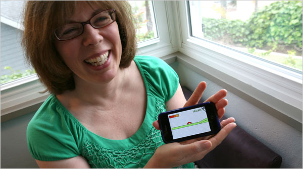 Casual gamer lady loves Fish Tycoon and Jelly Car games on the iPhone.